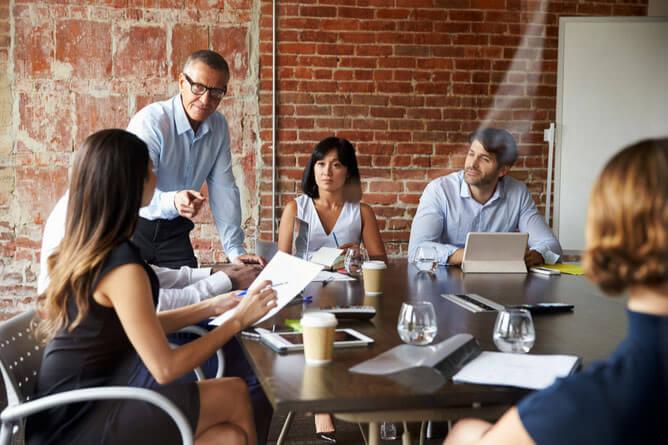 Office scene of franchise marketers
