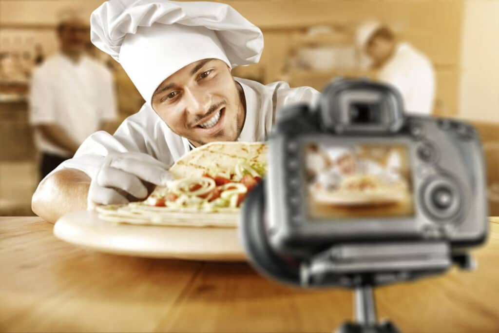 franchise executive chef shooting video of meal on a plate