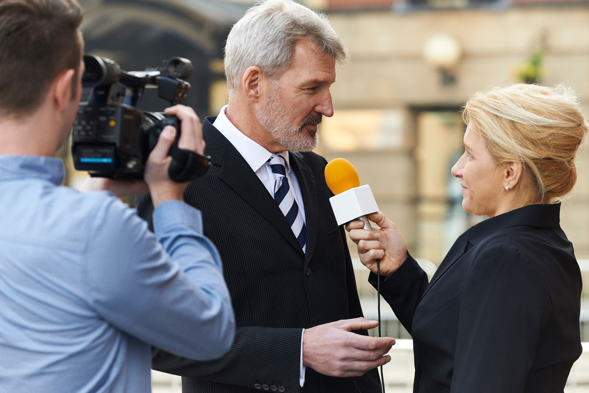 business man giving a new interview on camera